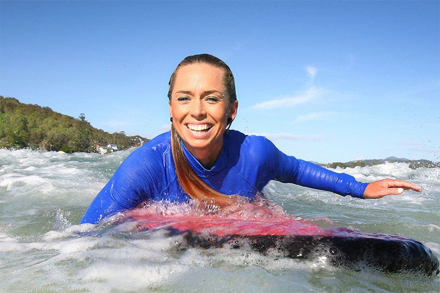 Ladies surfing – Learn to surf with Surfing Services