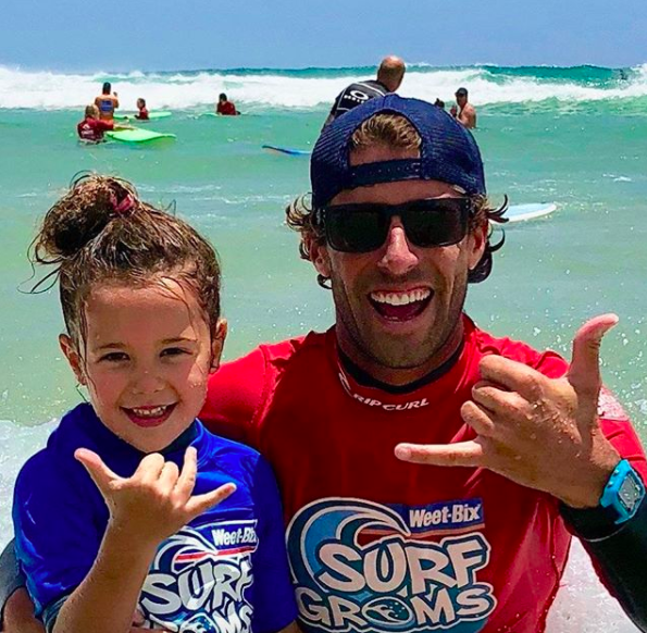 Stoked grom and coach at Surfing Services Australia, Currumbin Alley